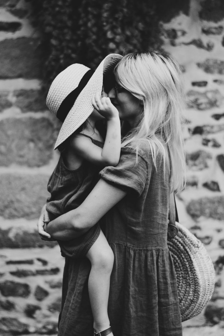 A lady and child embrace - poem about being a toddler